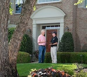 Lawn care salesman talking with a customer