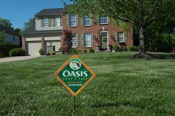 Oasis lawn care company sign in customer lawn