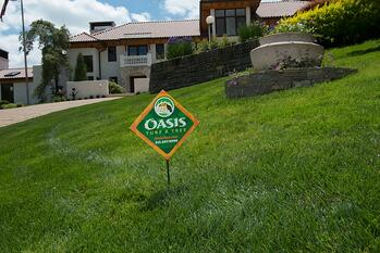 Oasis Turf & Tree lawn care sign in lawn with no crabgrass