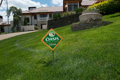 Oasis lawn care sign in nice lawn in Dayton, OH