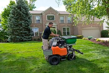 Oasis Turf & Tree technician performing lawn care services in Ohio