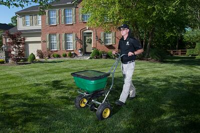 lawn care technician treating lawn in Dayton, OH