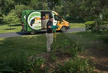 Mosquito control technician spraying property in Cincinnati