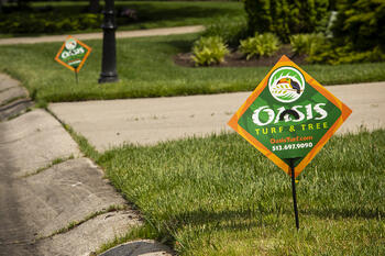 Oasis lawn care company sign in lawn