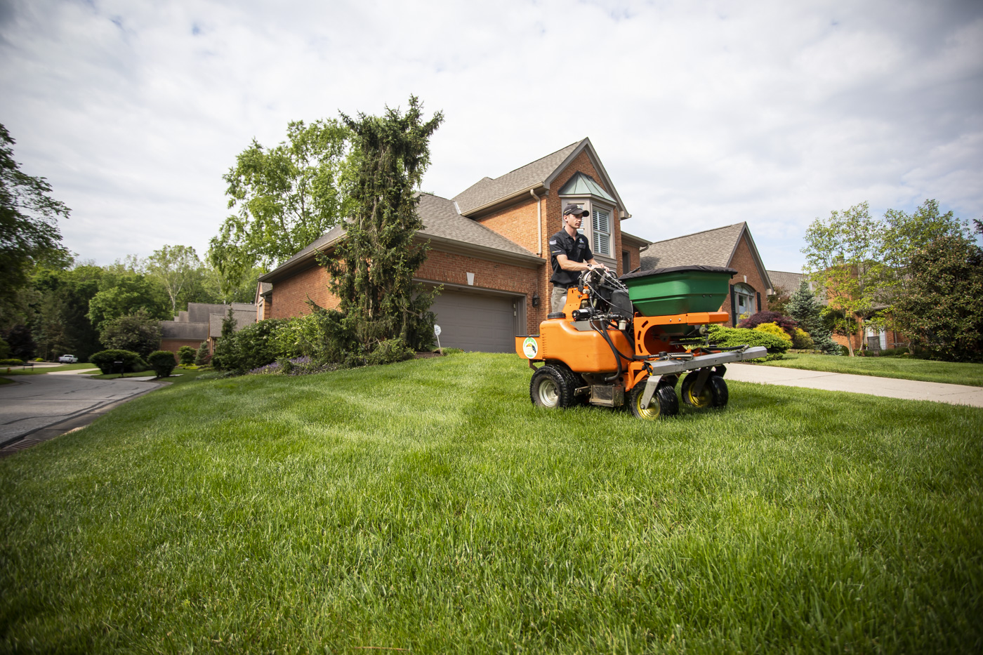 lawn technician applying crabgrass preventer