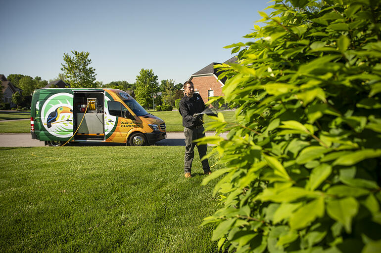 Oasis lawn care technician and van