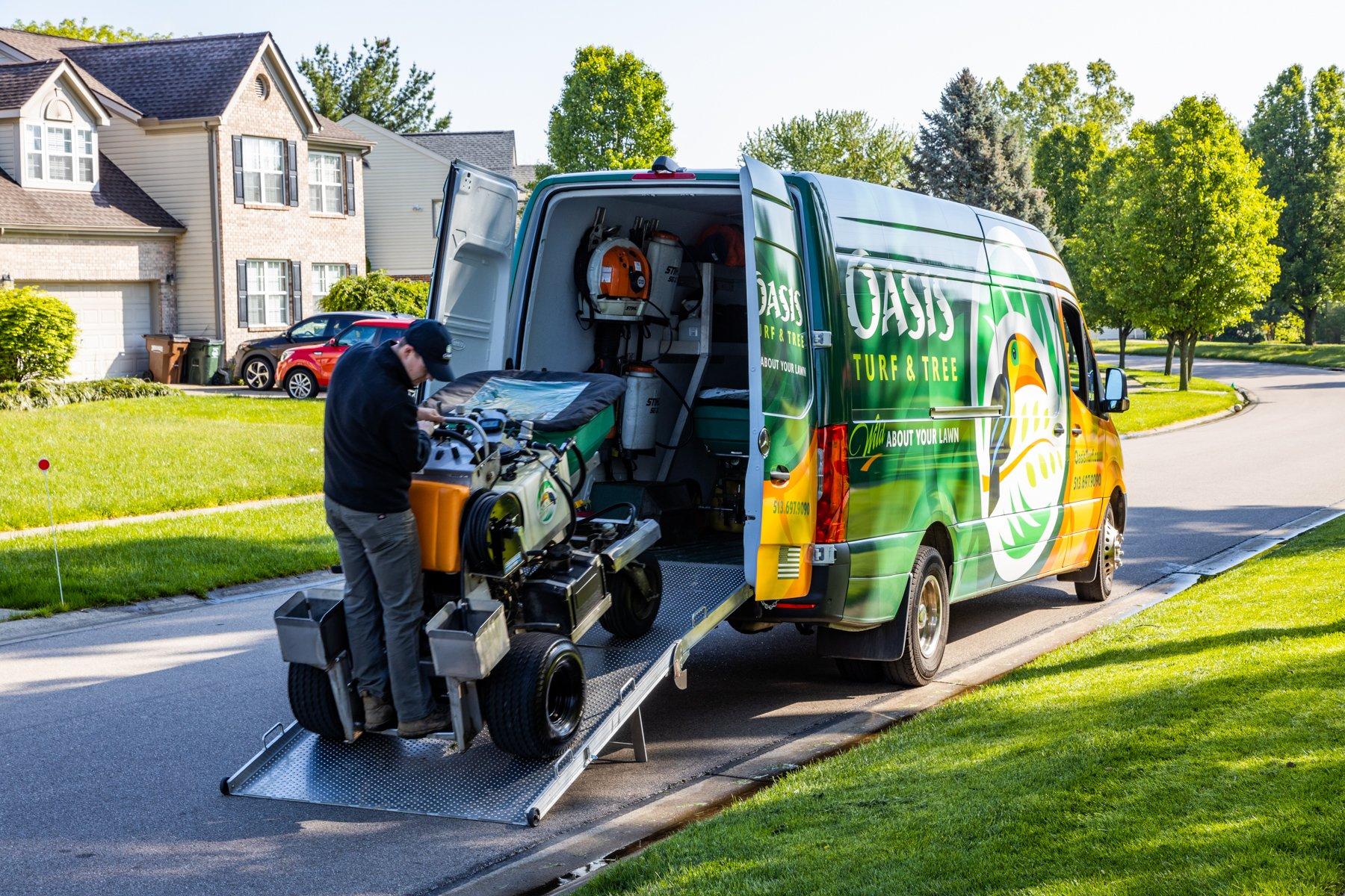 Oasis crew unloading fertlizer from van