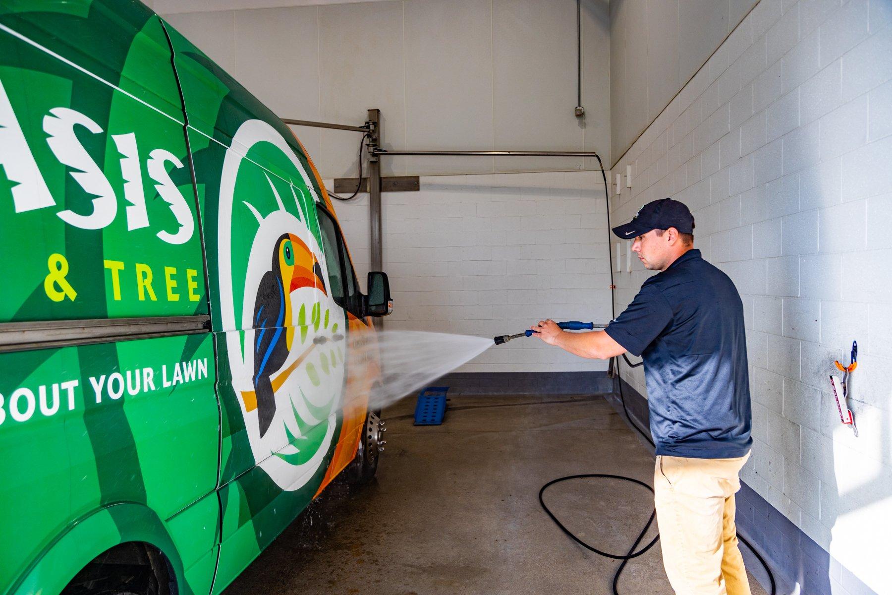 Oasis crew washing van and equipment in wash bay