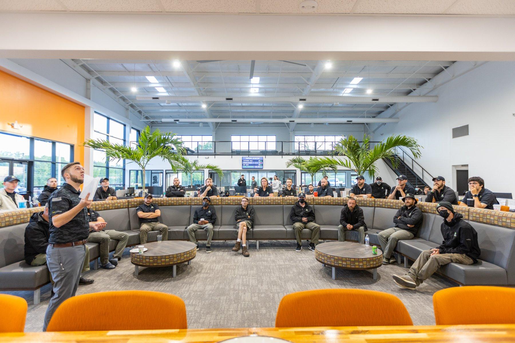 Oasis team meeting in new office building