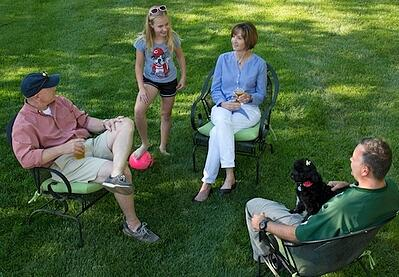 Family and dog in lawn with lawn care